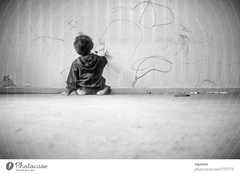 Child Wall (building) Graffiti Study Wallpaper Concentrate Pen Painting and drawing (object) Testing & Control Toddler Practice Parenting Human being Vandalism