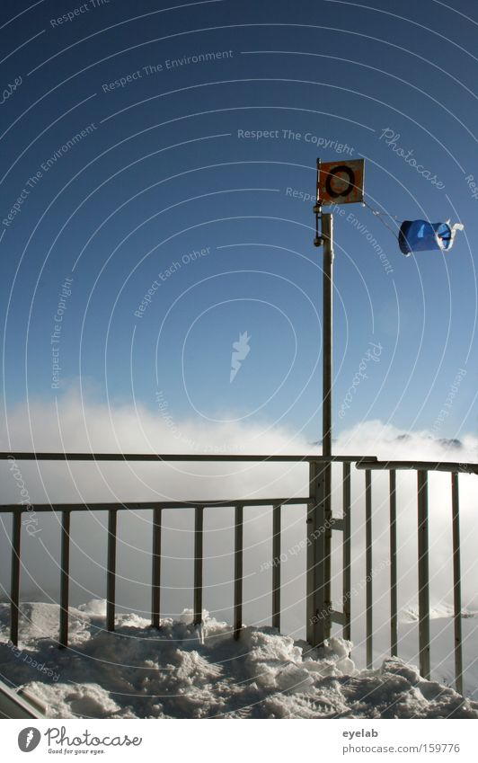 O in the wind Weather Sky Winter Clouds Mountain Barrier Peak Vantage point Far-off places Safety Vacation & Travel Platform Flag Tornado Wind Wind direction