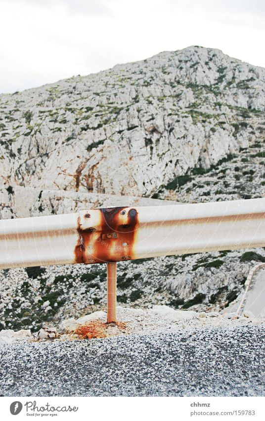 mountain road Colour photo Subdued colour Exterior shot Deserted Mountain Transport Street Rust Threat Protection Dangerous Tar Pass Roadside Crash barrier