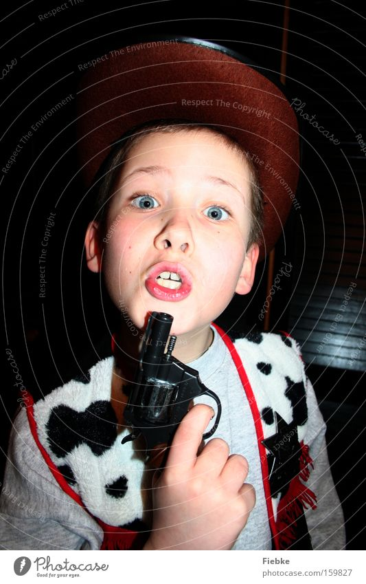 Child Joy Playing Boy (child) Infancy Dangerous Electricity Threat Carnival Anger Aggravation Carnival costume Costume Handgun Cowboy Problem