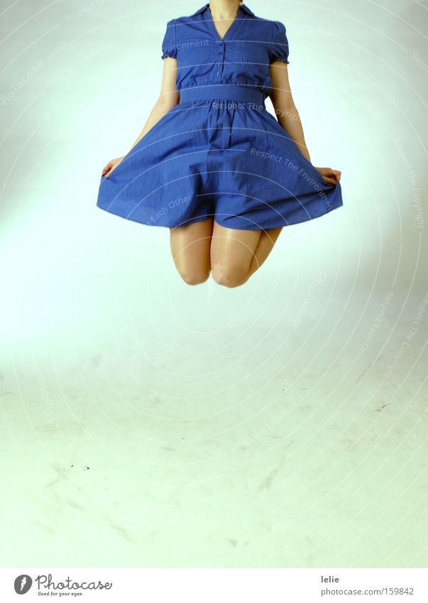 Woman Blue Jump Freedom Legs Flying Dress Wrinkles Knee Headless