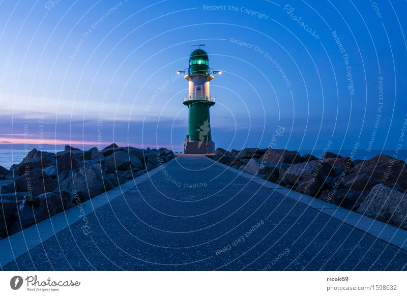 Pier light in Warnemünde Relaxation Vacation & Travel Tourism Ocean Nature Landscape Water Clouds Coast Baltic Sea Tower Lighthouse Architecture