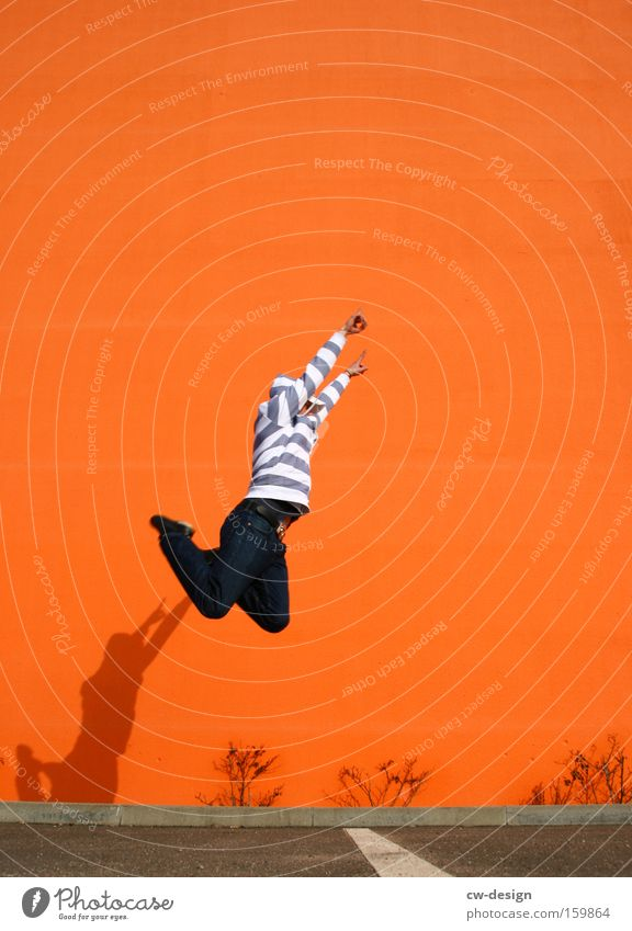 Man Joy Playing Wall (barrier) Jump Leisure and hobbies Guy Sweater Hooded (clothing) Faceless