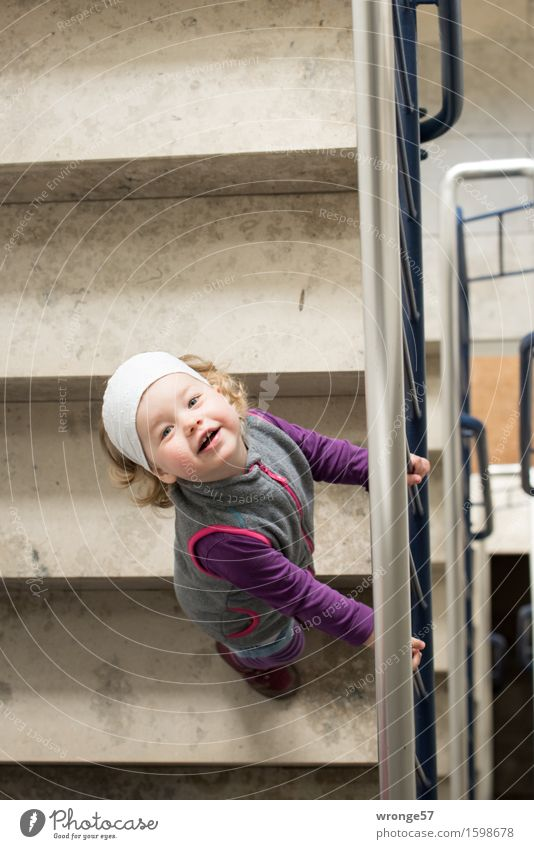 Human being Child White Joy Girl Feminine Gray Brown Stairs Happiness Wait Friendliness Violet To hold on Staircase (Hallway) Banister