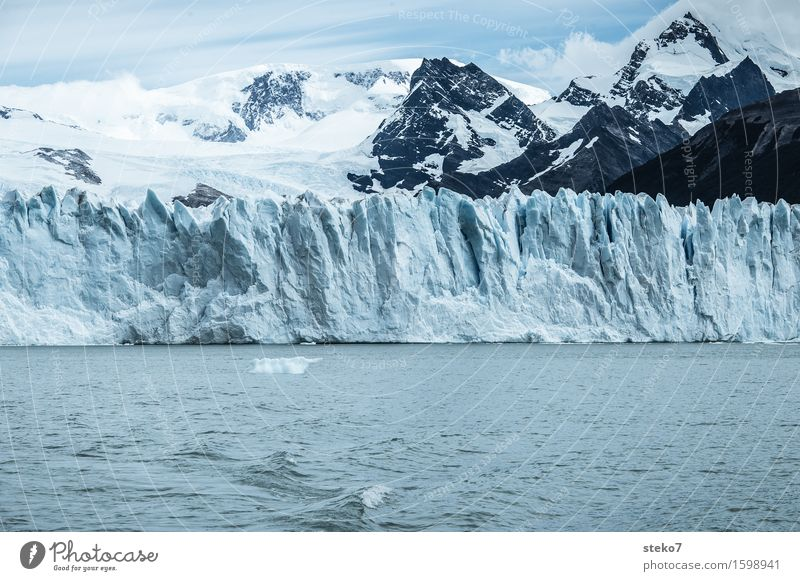 iceberg factory Mountain Snowcapped peak Glacier Coast Gigantic Cold Blue White Climate Transience Perito Moreno Glacier Edge Glacier ice Copy Space bottom