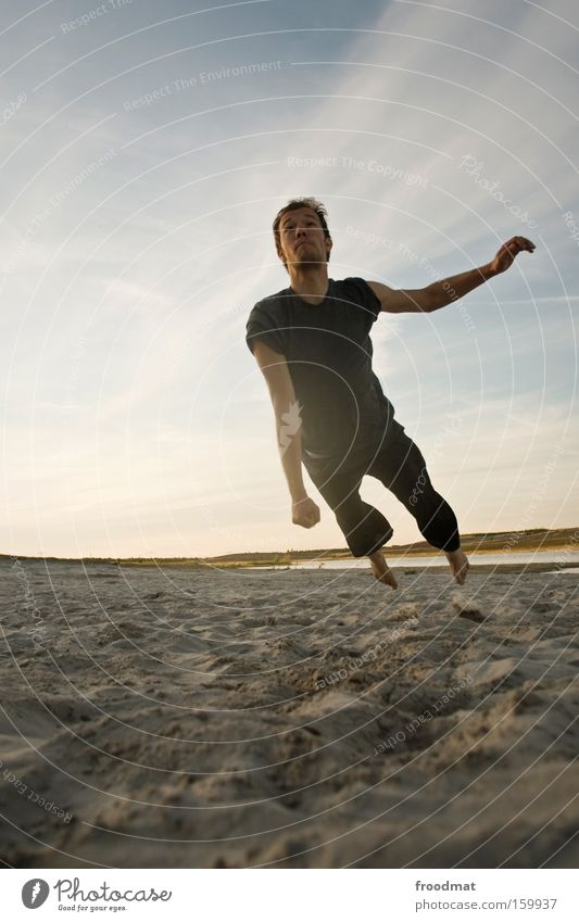 somersault Silhouette Sand Ball Back-light Youth (Young adults) Cool (slang) Warmth Athletic Playing Sunset Volleyball (sport) Jump Man Barefoot Tension Joy