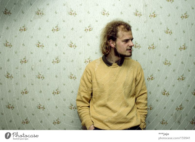 Human being Man Old Yellow Wall (building) Room Retro Serene Wallpaper Concentrate Facial hair Sweater Ask Location Lean Collar