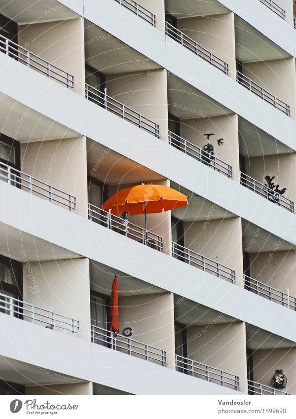 parasol Town House (Residential Structure) High-rise Architecture Hotel Facade Balcony Sunshade Orange Loneliness Uniqueness Identity Perspective