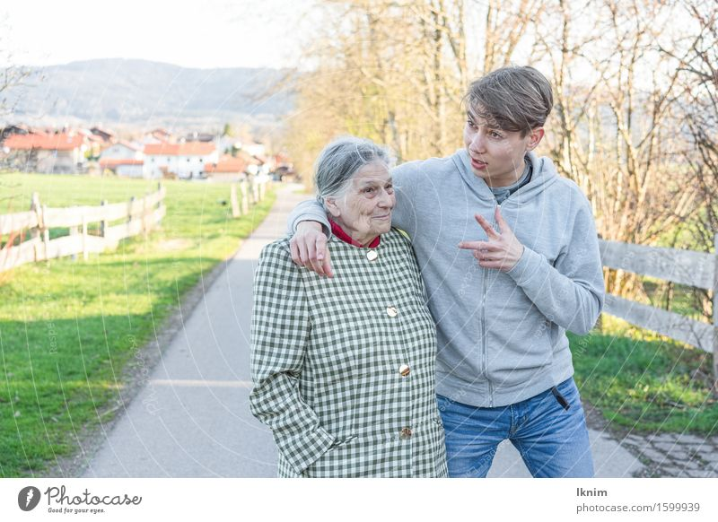young man and old woman talking during a walk Health care Care of the elderly Young man Youth (Young adults) Female senior Woman Grandmother Family & Relations