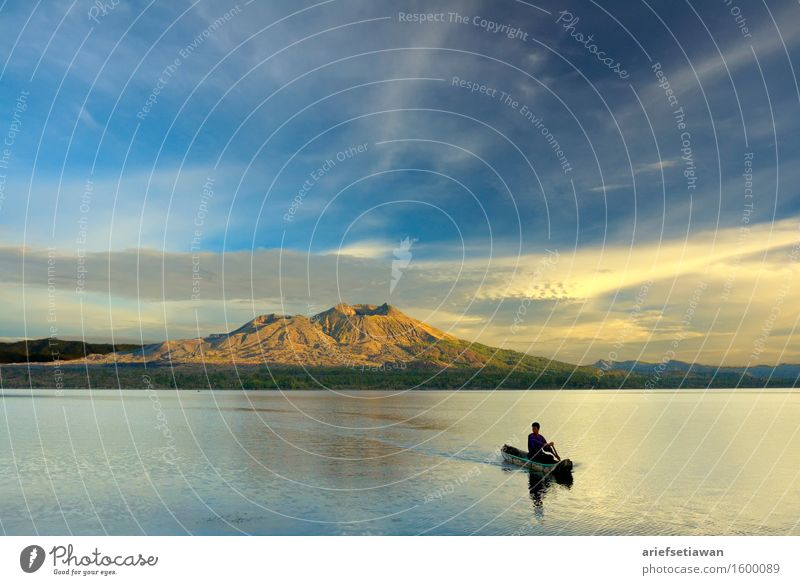 Paddling A Canoe in the Sunrise Human being Sky Nature Youth (Young adults) Man Blue Summer Water White Young man Landscape Clouds 18 - 30 years Mountain Black