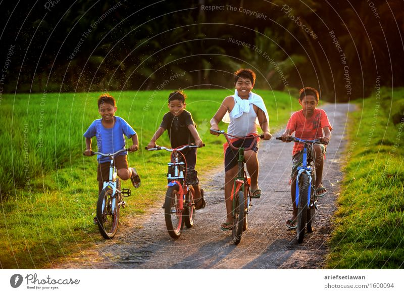 Four Children With Their Bicycles Human being Nature Plant Blue Summer Green White Landscape Red Joy Black Environment Emotions Movement Grass