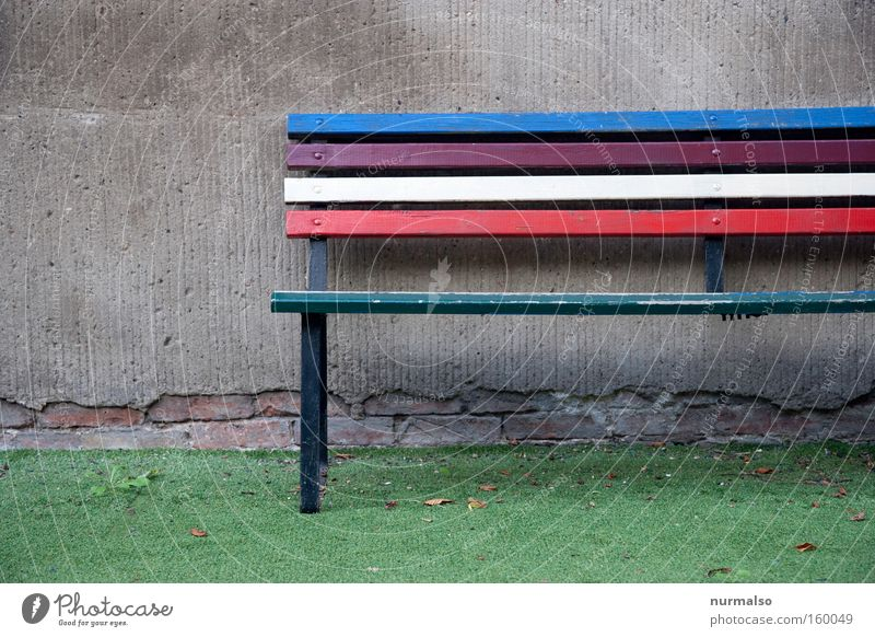Colorful square Bench Park bench Multicoloured Colour Rainbow Artificial lawn Kindergarten Schoolyard Wall (building) Gray Converse Wall (barrier) Calm