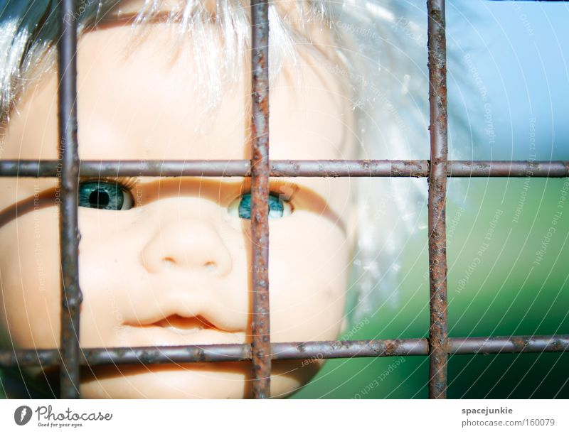Behind bars Grating Iron Captured Loneliness Doll Toys Plastic Head Looking Longing Freedom Escape Eyes Penitentiary Fear Panic