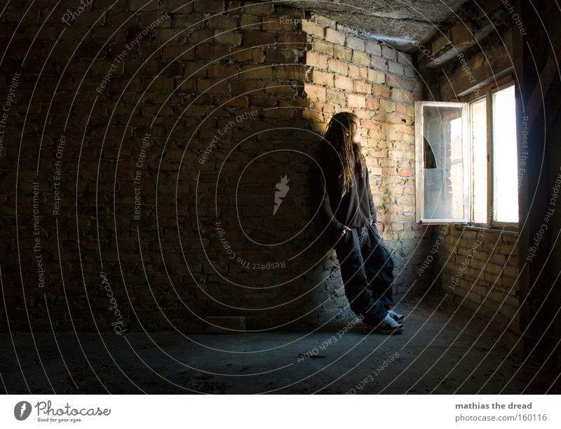 Human being Man Red Wall (building) Window Bright Room Wait Cool (slang) Stand Transience Interior design Derelict Brick Easygoing Flashy