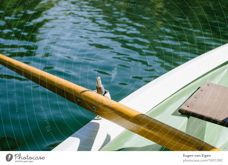 Rowing a rowing boat in an alpine lake Well-being Relaxation Calm Camping Summer vacation Sun Water Lake Mountain lake Rowboat Safety To console Grateful