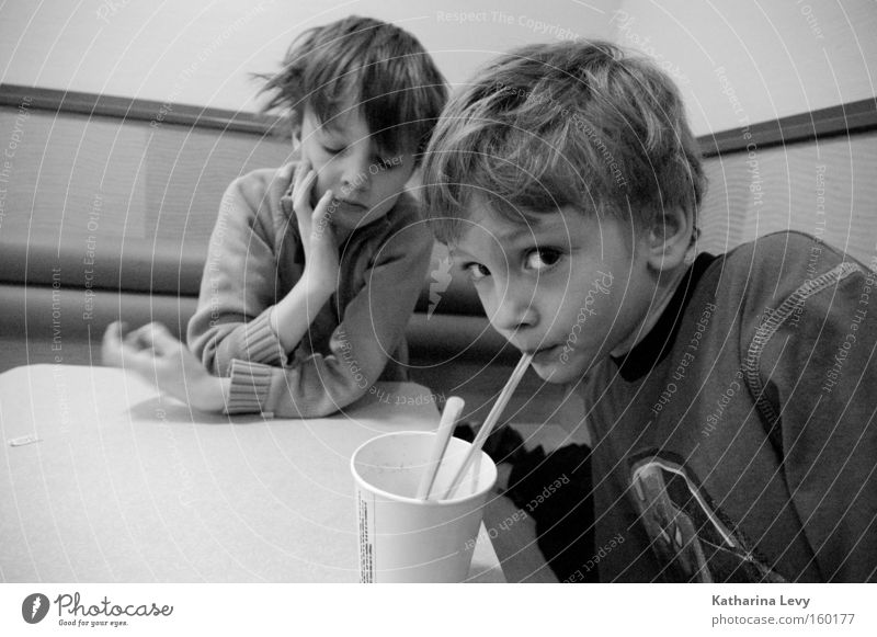 fast food Black & white photo Interior shot Central perspective Wide angle Looking into the camera Beverage Drinking Mug Straw Child Human being Boy (child)