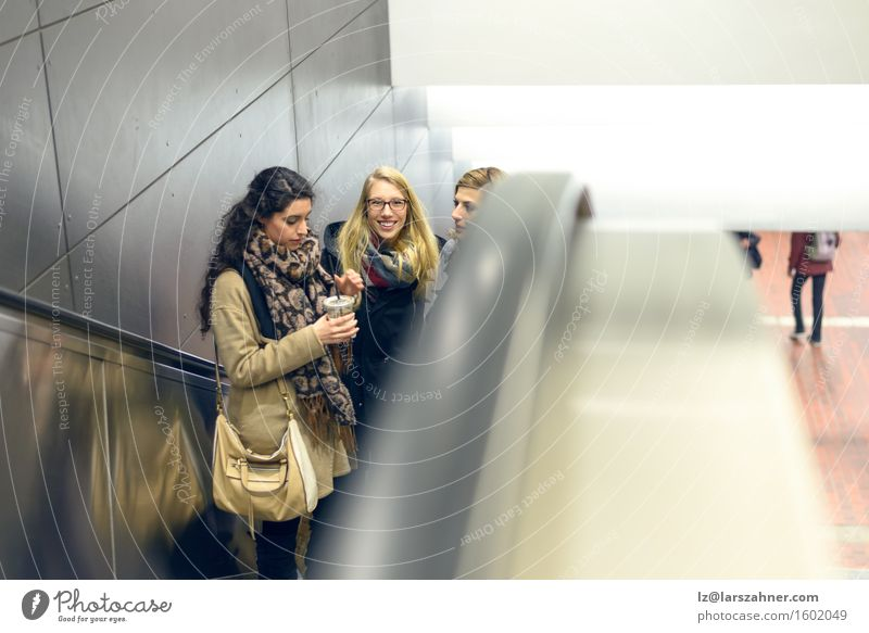 Three young women moving up escalator Human being Woman Youth (Young adults) 18 - 30 years Adults Happy Friendship Copy Space Blonde Smiling Railroad Brunette