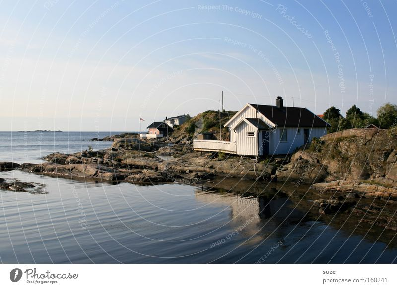 The house by the sea Contentment Relaxation Calm Environment Nature Landscape Elements Air Sky Cloudless sky Summer Beautiful weather Hill Rock Coast Fjord Hut