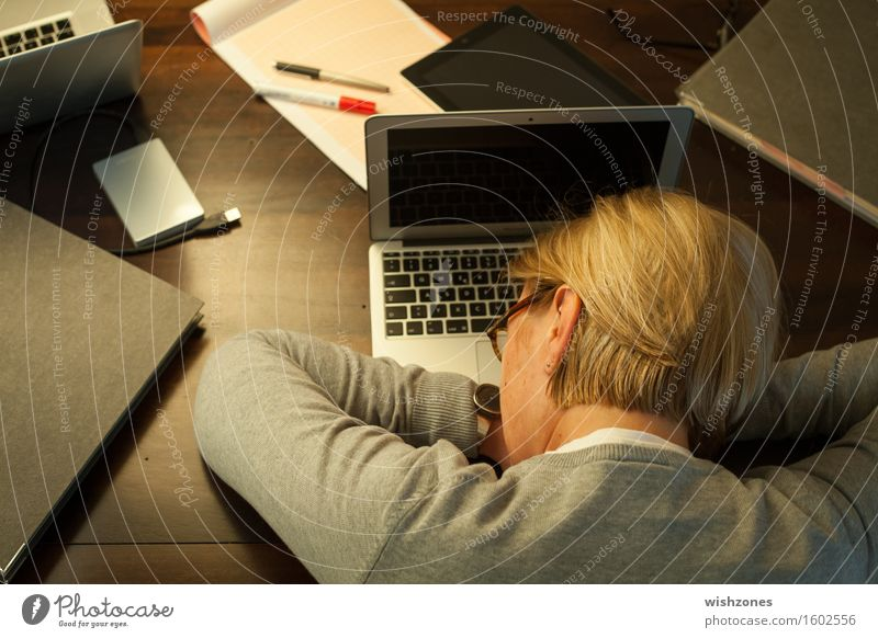 Woman sleeping on office desk Computer Notebook Keyboard Technology Adults 1 Human being 45 - 60 years Stationery File Relaxation Sleep Dream Blonde Broken