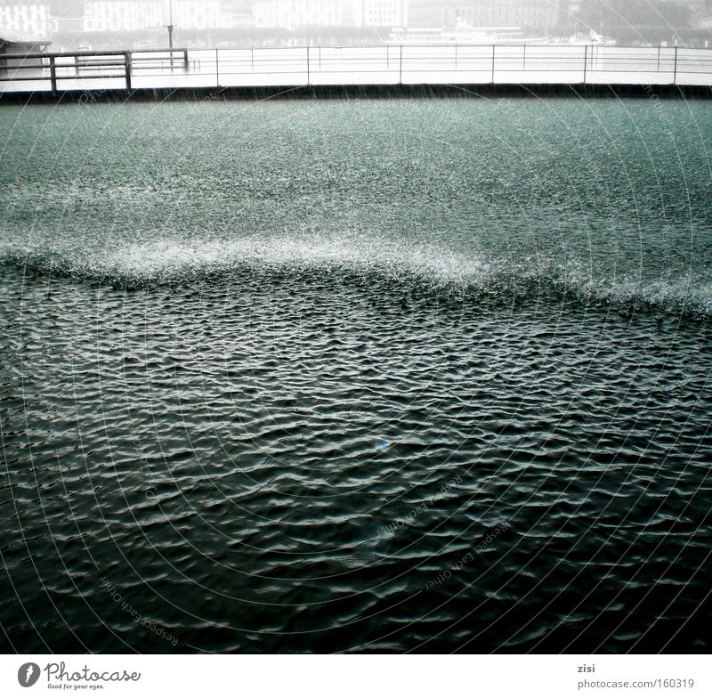Rain washes Lucerne clean Water Lakeside Deserted Dark Lake Lucerne Colour photo Subdued colour Exterior shot Bridge Surface of water Copy Space bottom Curls