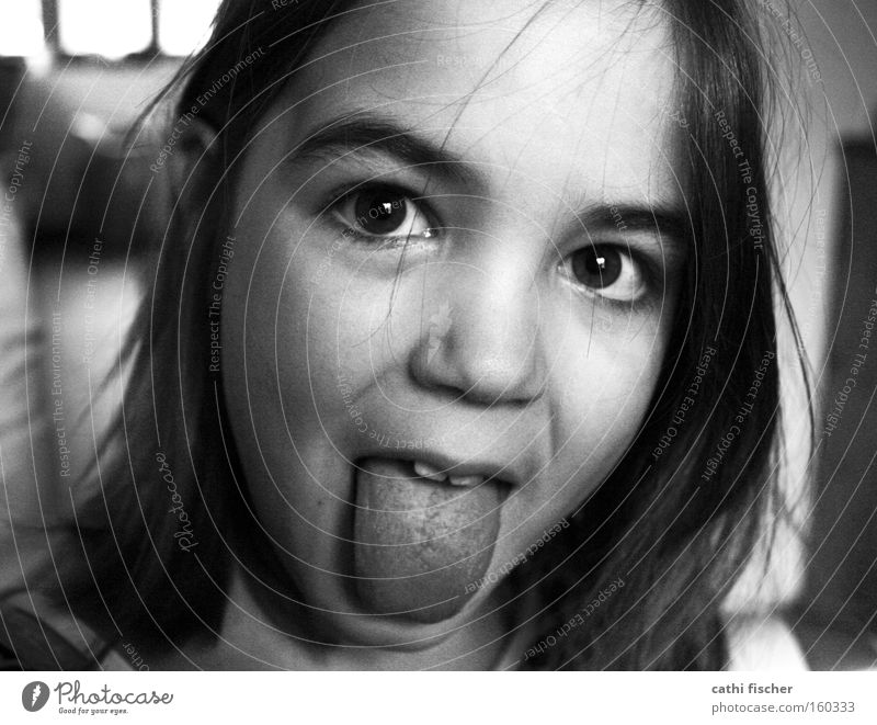 little witch Girl Child Tongue Face Eyes Hair and hairstyles Portrait photograph Nose Joy Brash Funny Grimace Gray Black & white photo snot-nosed nose Infancy