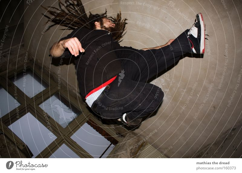Man Youth (Young adults) Window Movement Hair and hairstyles Jump Room Action Derelict Dynamics Dreadlocks Trajectory Ankle bone