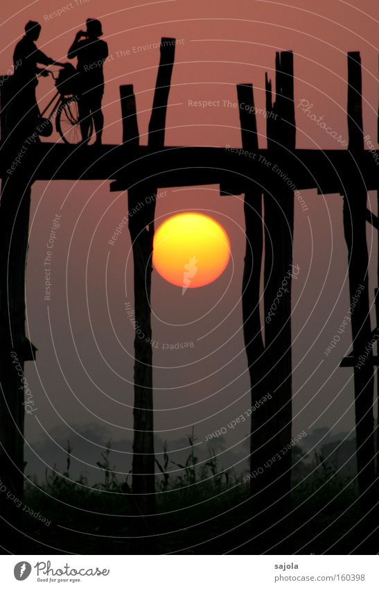 silhouettes before glowing sun Vacation & Travel Tourism Adventure Sun Bicycle Human being 2 Myanmar Asia Bridge Esthetic Yellow Beautiful Exotic Moody Sunset