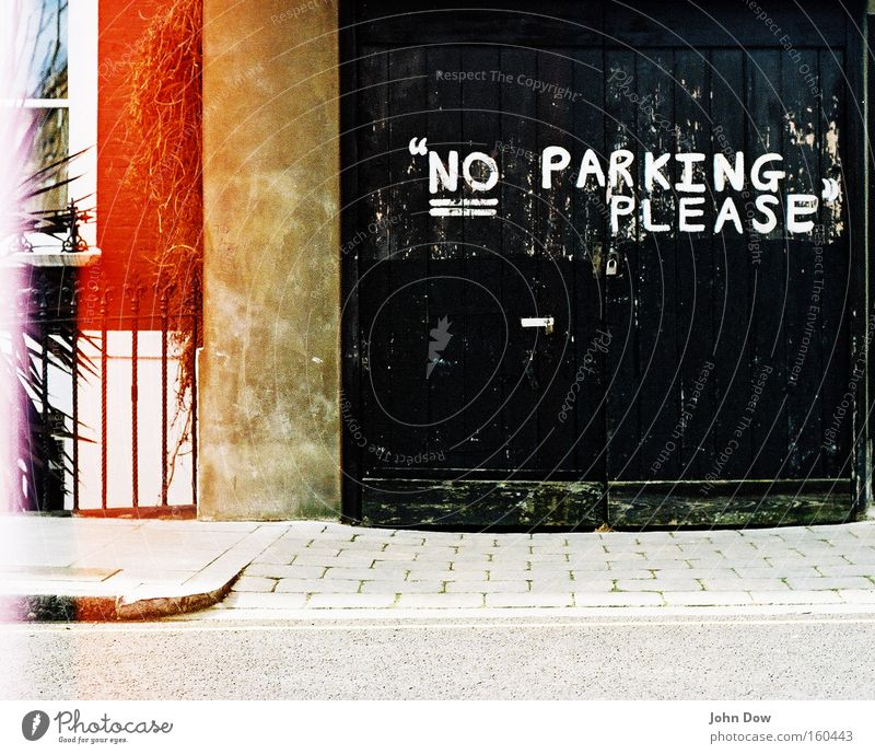 City Black Graffiti Facade Characters Letters (alphabet) Analog Friendliness Sidewalk Signage Laws and Regulations Traffic infrastructure Parking England Bans