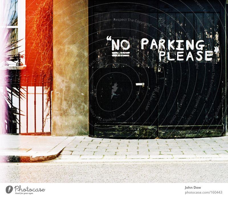 Polite parking ban. Garage Garage door Parking area Facade Traffic infrastructure Characters Signage Warning sign Graffiti Friendliness Black Bans Clearway