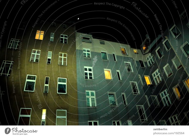 Lightened backyard Backyard House (Residential Structure) Town house (City: Block of flats) Tower block Apartment house Night Window Facade Flat (apartment)