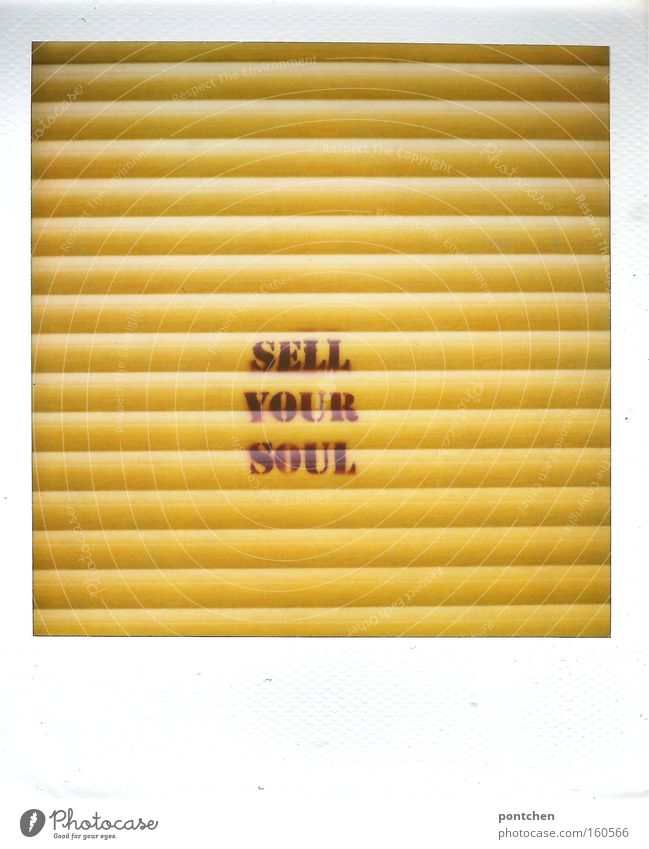 """""""Sell your soul"""" is written on the yellow shutter of a store. History, betrayal, soul. Culture Youth culture Subculture built Decoration Characters Graffiti"""