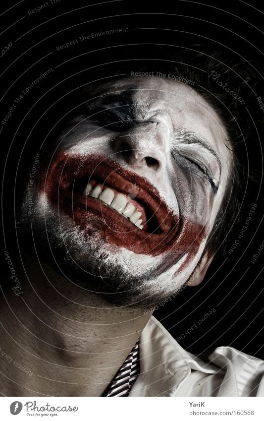 laugh to death Laughter Grinning Clown Mouth Teeth Make-up Wearing makeup Dress up Mask Face Nerviness Anxious Evil Dark Anger Aggravation Intellect Carnival
