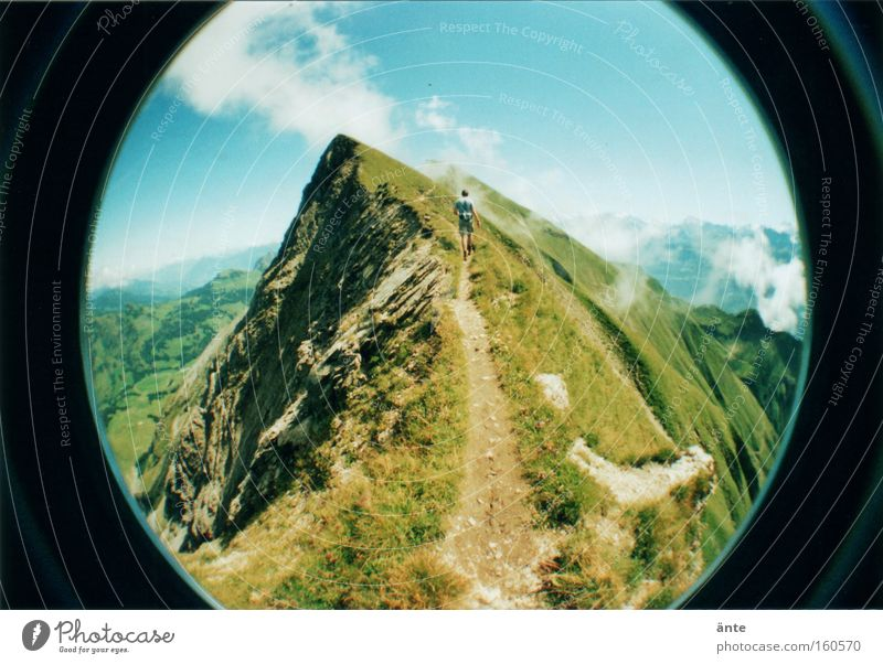tightrope walk Colour photo Exterior shot Lomography Holga Copy Space top Day Sunlight Deep depth of field Wide angle Fisheye Rear view Mountain Hiking Climbing