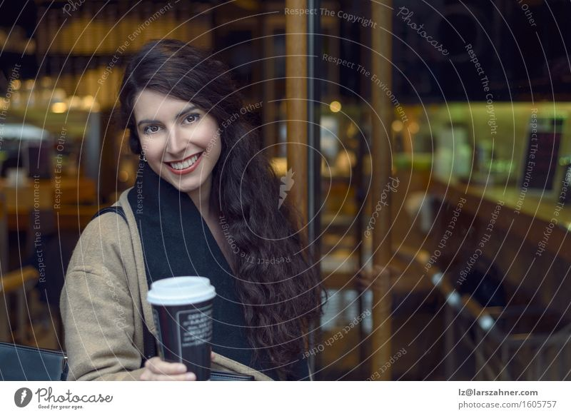Young brunette woman leaving a coffee bar Human being Woman Youth (Young adults) Winter 18 - 30 years Adults Feminine Going Copy Space Blonde Stand Smiling