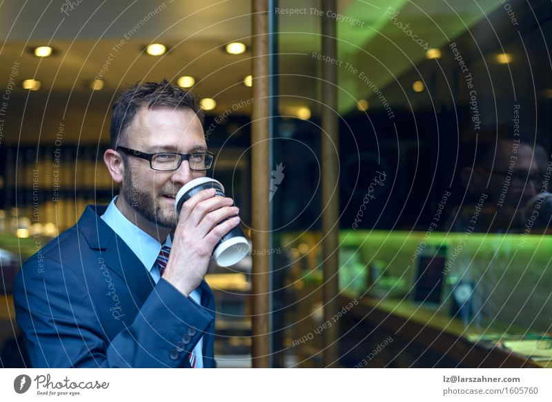 Middle-aged man in business suit sipping coffee from a cup Coffee Business Man Adults 1 Human being 30 - 45 years Suit Tie Eyeglasses Beard Going Smiling