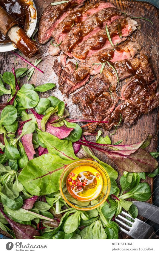 Grilled sliced steak served with green salad Food Meat Vegetable Lettuce Salad Herbs and spices Cooking oil Nutrition Lunch Dinner Banquet Picnic