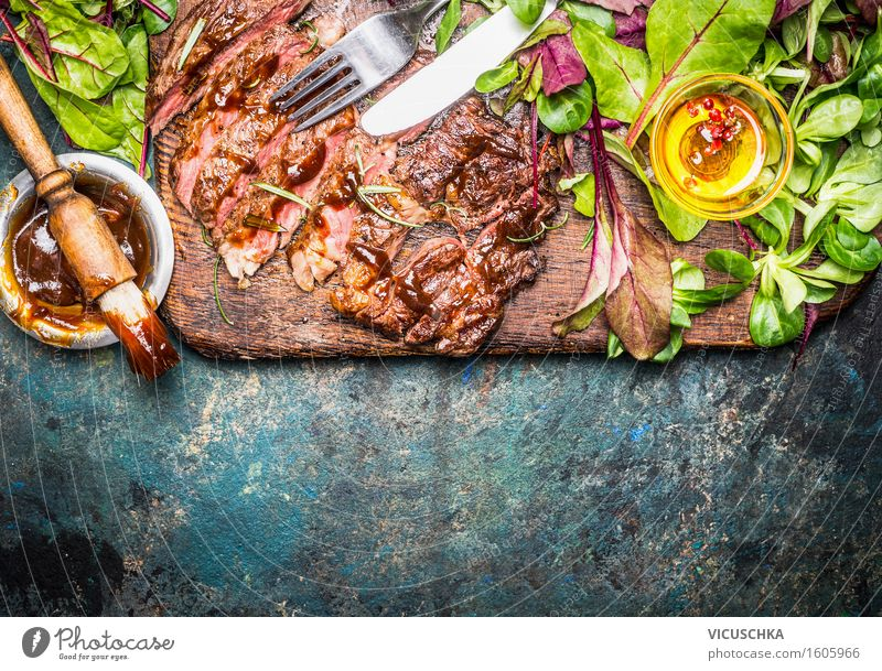 Grilled steak served with green salad and barbecue sauce Food Meat Lettuce Salad Nutrition Dinner Banquet Picnic Bowl Cutlery Style Healthy Eating Table Kitchen