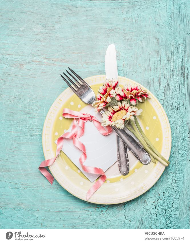 Table with card and pretty flowers Banquet Crockery Plate Cutlery Knives Fork Elegant Style Design Living or residing Interior design Decoration Restaurant