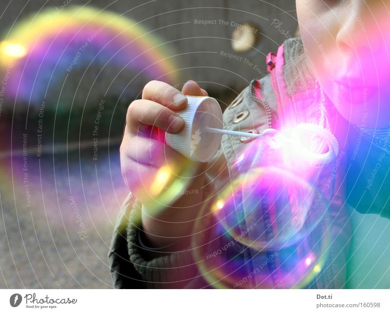 Child with colourful soap bubbles Colour photo Multicoloured Exterior shot Copy Space left Day Reflection Upper body Joy Playing Human being Toddler Girl