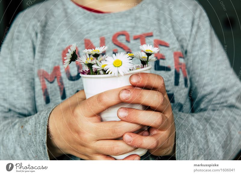 Human being Child Hand Flower Blossom Boy (child) Lifestyle Playing Happy Flat (apartment) Masculine Living or residing Leisure and hobbies Body Birthday