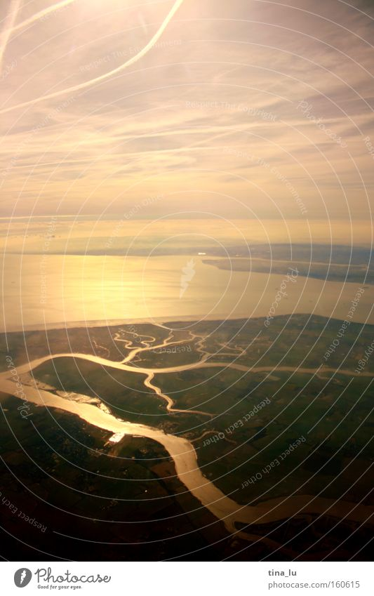 Sky Sun Ocean Lighting Airplane Fog River London Brook Haze Themse Mouth of a river Delta