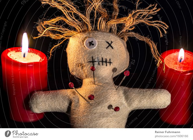 a Voodoo doll between two red candles (Stacking) Exotic Hallowe'en Art Work of art Subculture Shows Doll Kitsch Odds and ends Collector's item Emotions Belief