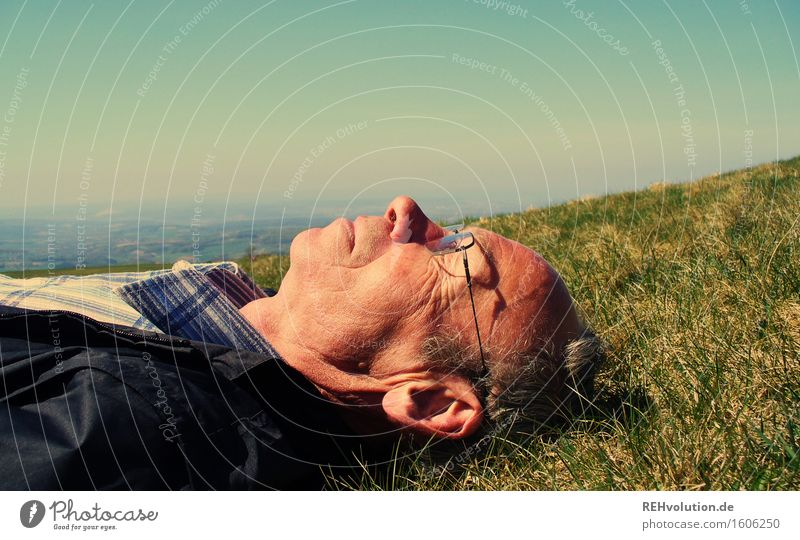 Senior lies in a meadow Human being Masculine Man Adults Male senior 1 45 - 60 years 60 years and older Senior citizen Environment Nature Landscape Plant Sky