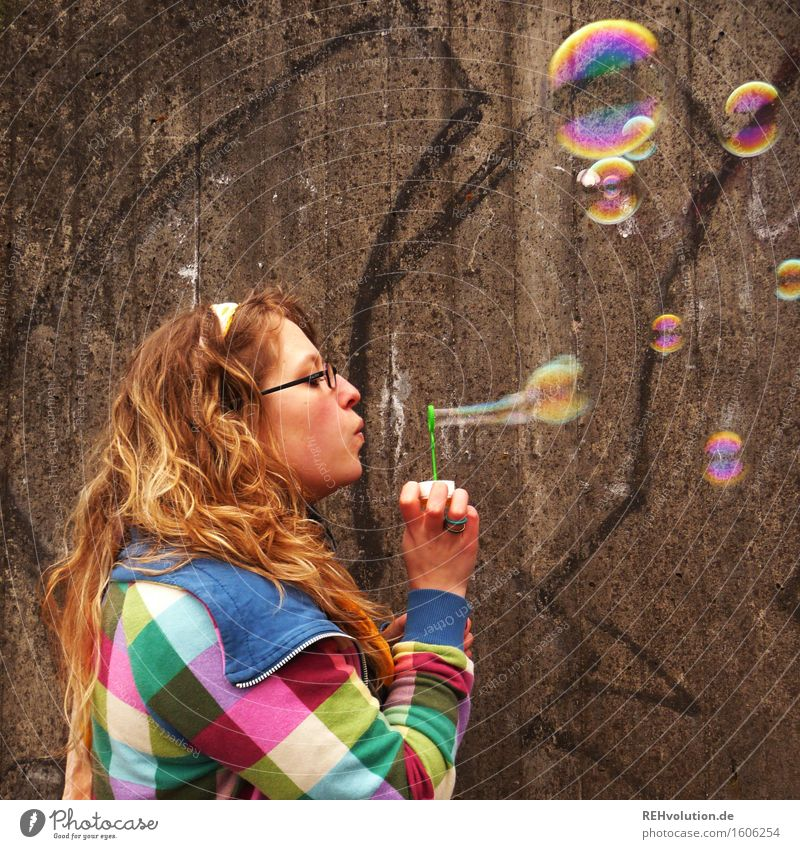 Young woman blows soap bubbles Human being Feminine Youth (Young adults) 1 18 - 30 years Adults Sweater Blonde Curl Playing Joy Happy Happiness Contentment