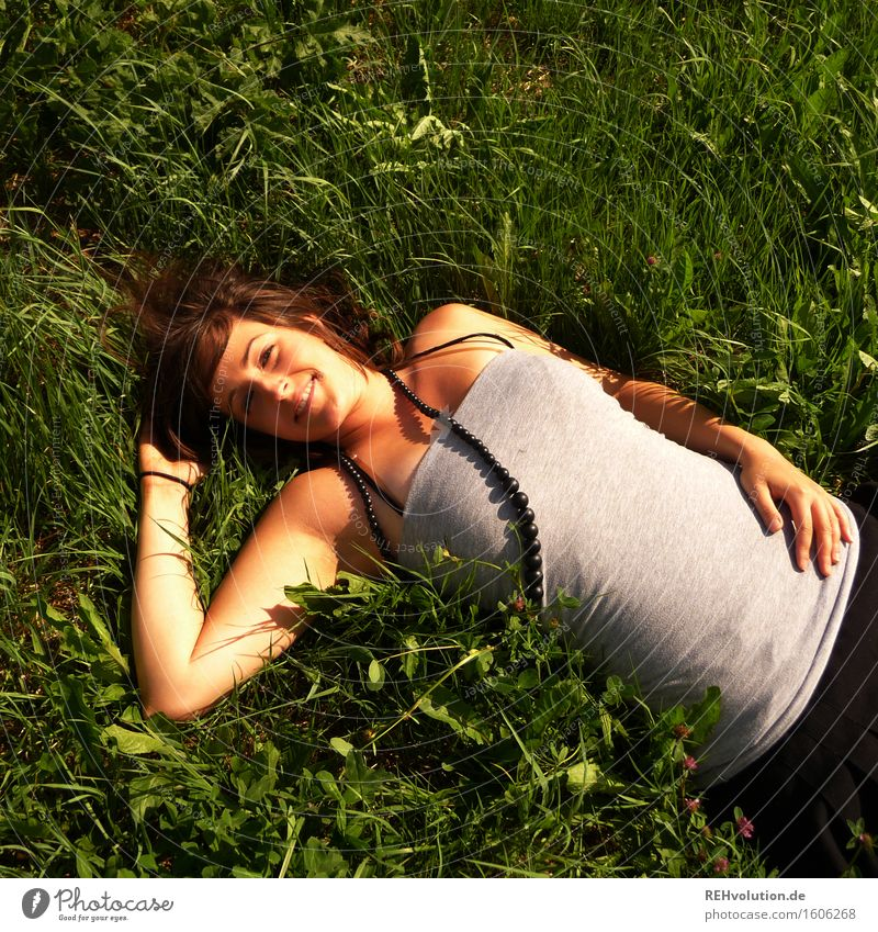 sunbathe Human being Feminine Young woman Youth (Young adults) 1 18 - 30 years Adults Meadow Jewellery Brunette Lie Green Joy Happy Happiness Contentment