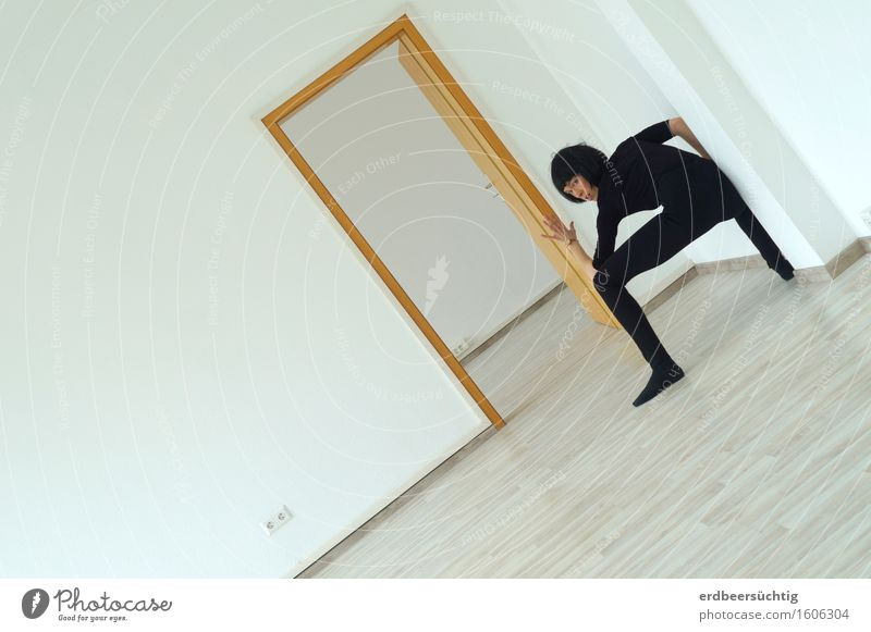 Stable Androgynous Woman Adults Wall (barrier) Wall (building) Door Sweater Tights Black-haired Bangs Observe Stand Athletic White Movement Testing & Control