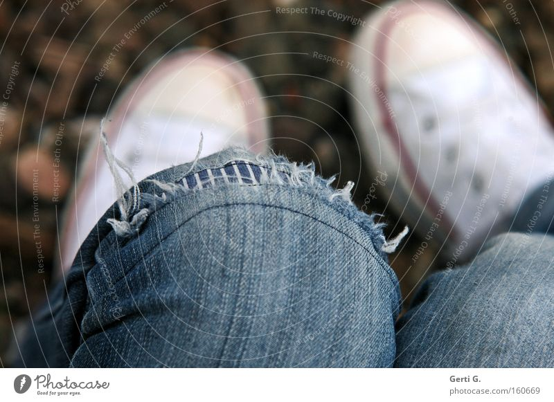 Human being Youth (Young adults) Relaxation Footwear Legs Broken Cloth Derelict Denim Boredom Chucks Knee Sneakers