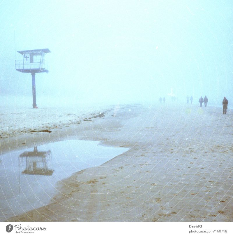 beach walk Beach Coast Sand Ocean Baltic Sea Tower Lifeguard Medic Fog To go for a walk Puddle Human being Reflection Winter Group
