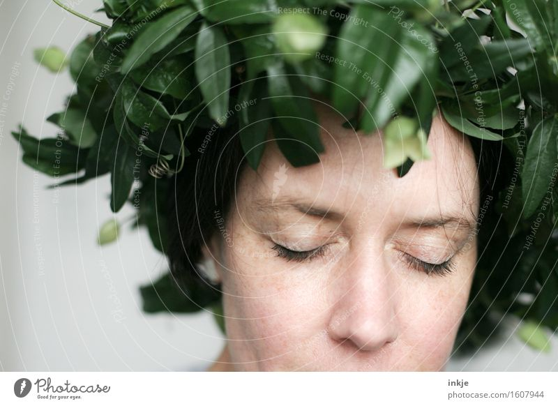 headdress Lifestyle Style Beautiful Woman Adults Face 1 Human being Leaf Passion flower Creeper Flower wreath Dream Exceptional Green Emotions Romance Caution