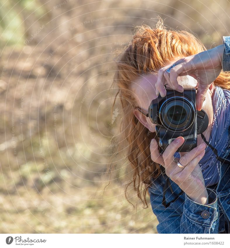 a woman takes pictures with a digital camera Take a photo Profession Photographer Advertising Industry Feminine Woman Adults 1 Human being Hunting Culture Art